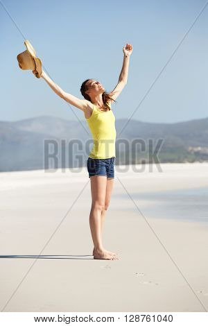 Young Woman On The Beach With Hands Wide Open