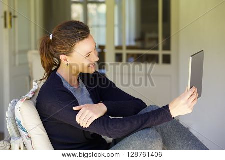 Beautiful Woman Making Video Call Using Digital Tablet