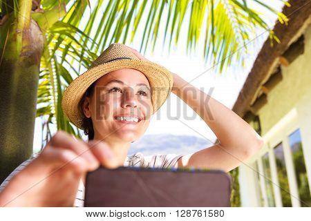 Beautiful Young Woman Taking Selfie In Backyard