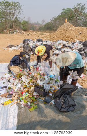 PAI, THAILAND - April 10, 2016 : Councils officer prepare Screeners in the garbage disposal pond in Pai,Thailand