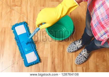 Wash wood floor mop. Housekeeping concept. A bucket of water and mop. top view