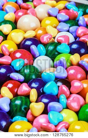 multicolored candy and chewing gum background. focus in the middle of the frame