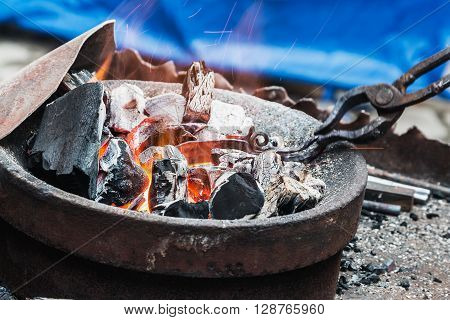 forge a burning forge and tools. focus on the coals and sparks