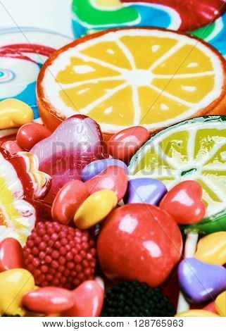 multicolored lollipops candy and chewing gum background.