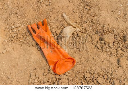 dirty rubber gloves on the soil floor