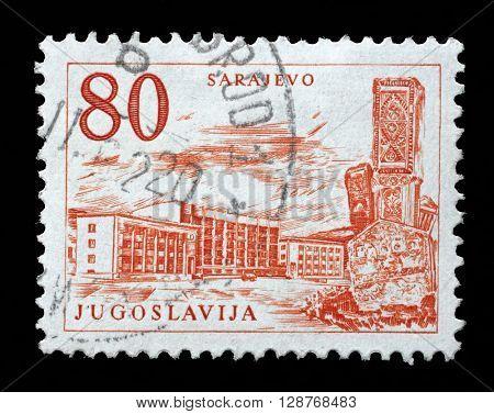 ZAGREB, CROATIA - JUNE 14: A stamp printed in Yugoslavia shows Sarajevo railway station and obelisk, Bosnia and Herzegovina, circa 1958, on June 14, 2014, Zagreb, Croatia