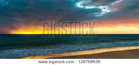 Beach and dramatic stormy sky at sunset South Australia
