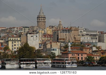 ISTANBUL/TURKEY-OCTOBER 14, 2014: Galata Tower is a historic building at Beyoglu. October 14, 2014- Istanbul/Turkey