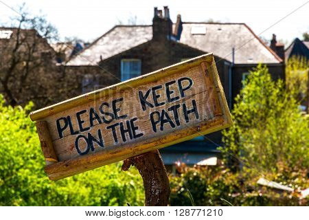 Wooden sign of Please Keep On The Path ** Note: Visible grain at 100%, best at smaller sizes