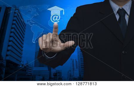 Businessman pressing e-learning icon over map and city tower Study online concept Elements of this image furnished by NASA