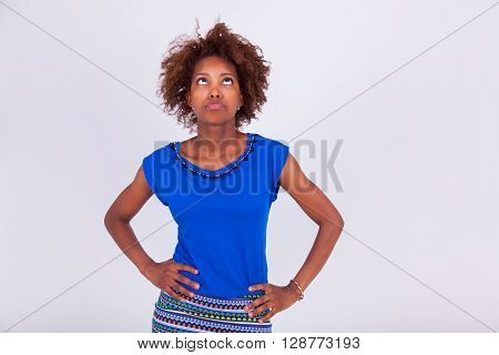 Young Black African American Woman With Frizzy Afro Hair Looking Up