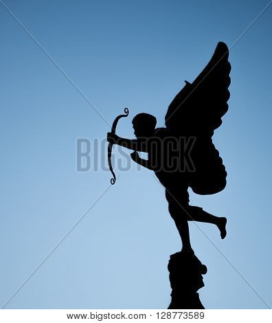 Cupid statue with photo in silhouette style