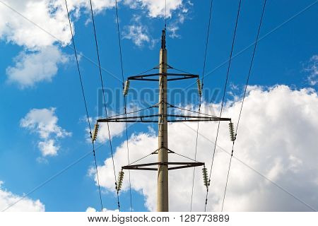 High-voltage power line on a  sky background