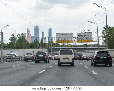 Moscow - May 6 2016: Lots of cars driving on the Third Ring Road in the direction of the complex of skyscrapers Moscow City May 6 2016 Moscow Russia