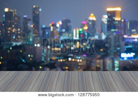 Opening wooden floor, aerial view blurred bokeh lights city office building night view