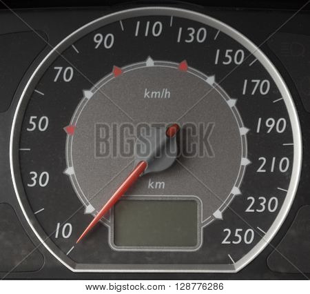 A speedometer with a kilometer scale at zero