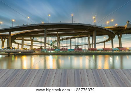 Opening wooden floor, highway ring road interchanged with moving sky background