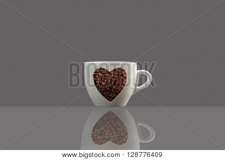 a coffee cup a love shape and a reflection