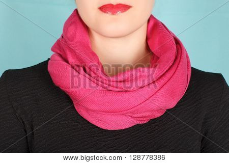 Silk Scarf. Pink Silk Scarf Around Her Neck Isolated On Blue Background.