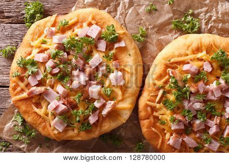 Langos Deep Fried With Cheese And Ham Close-up. Horizontal Top View