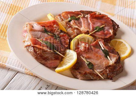 Italian Saltimbocca Veal With Sage, Ham And Lemon. Horizontal