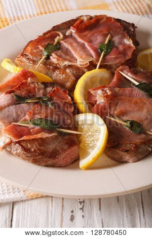 Italian Beef Saltimbocca With Sage, Ham And Lemon Close-up. Vertical