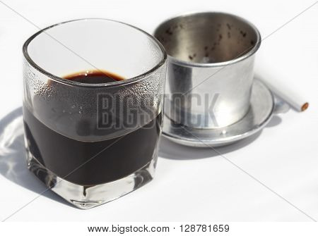 vietnamese cofe and cigarette with ashtray isolated on white close up, unhealthy breakfast
