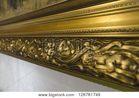 Golden picture frame with 3D pattern. Closeup view background