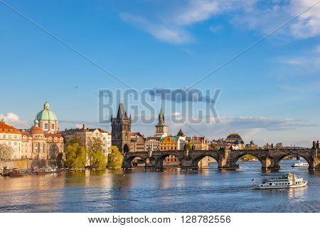 Prague, Czech Republic skyline with historic Charles Bridge and Vltava river on sunny day.