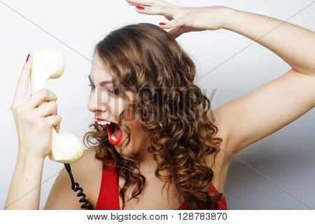 beautiful curly woman  talking on white telephone