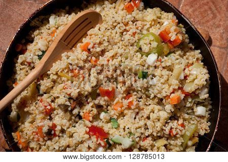 homemade bulgur with vegetables on a table