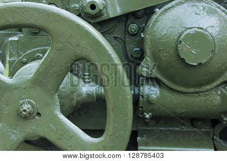 military green background with artillery metal mechanism