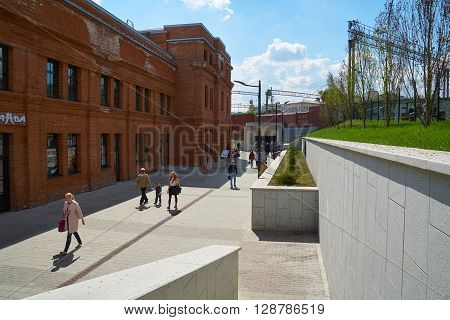 Moscow Russia - May 06 2016: People walking on Nizhniy Susalniy pereulok (lane) near Arma factory in Moscow