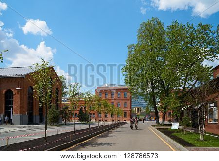 Moscow Russia - May 06 2016: View of Arma factory buildings and some pedestrians walking by. Nizhniy Susalniy pereulok (lane) in Moscow.