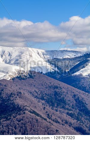 Mountain Peaks Covered With Snow. Vertical Panoramic View With High Mountains Partial Covered With S