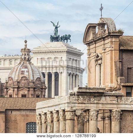 Compressed perspective of Roman lendmarks. Ruins of the Roman Forum, Basilica di Santa Maria in Ara coeli, Mamertine Prison, Curia Iulia and Terrazza delle Quadrighe in Rome, Italy.