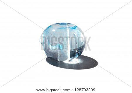 Hand made blue transparent glass bead on white background