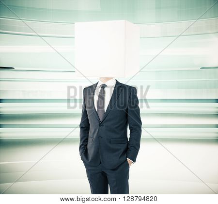 Businessman with box instead of head on abstract green background