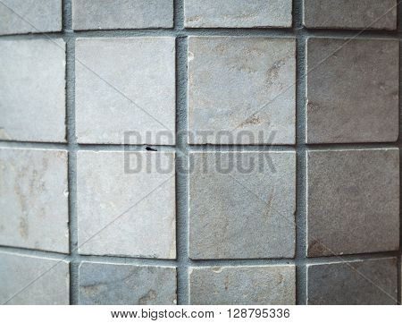 gray stone wall background with a distinctive structure