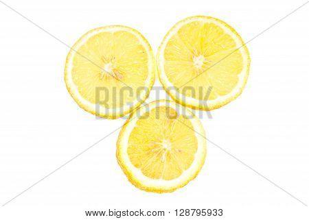 Three lemon  sliced isolated on white background