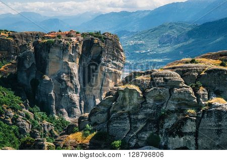 View of The Holy Monastery of St. Stephen at the complex of Meteora monasteries in Greece. Steep cliffs and mountains in the valley of Thessaly