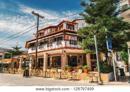 HANIOTI GREECE - MAY 26 2015: Typical building on the central square in Hanioti on Kasandra penisula Halkidiki Greece