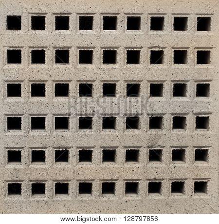 Closeup of an air brick on a modern building.