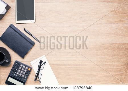 Wooden desktop with office tools on its left side. Topview Mock up