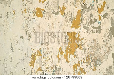 Textured architecture background - peeling sepia stucco and brown peeling paint with cracks on the old rough wall surface. Grunge background.