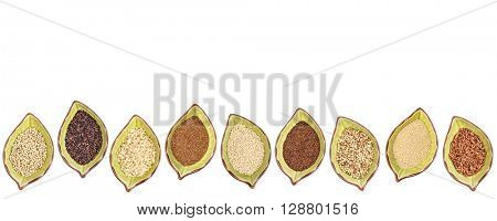 nine gluten free grains (millet, black quinoa, buckwheat, amaranth, teff, sorghum, kaniwa,  and brown rice) - a row of leaf shaped ceramic bowls isolated on white