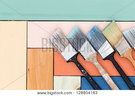 Neat Arrangement Of Paintbrushes On Stained Wood