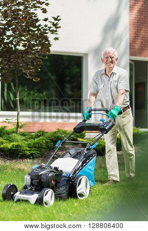 Gardener Using A Modern Lawnmower