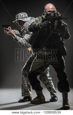 Special Forces Soldiers Men With Machine Gun On A  Dark Background
