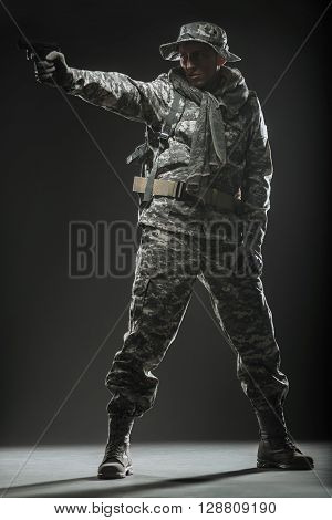 Special Forces Soldier Man With Gun On A  Dark Background